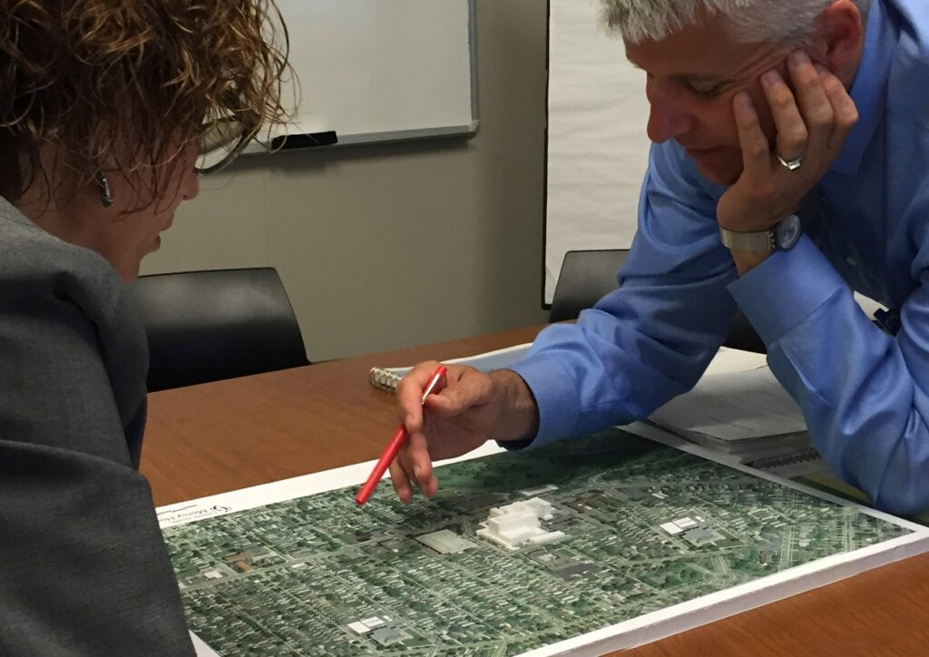 Client discussion of campus development options during a planning work session